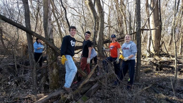 EPIC volunteering helps remove invasive brush.